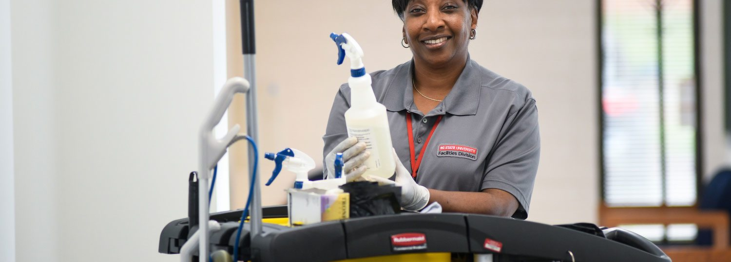 NC State housekeeping employee Benita Womack with cleaning supplies