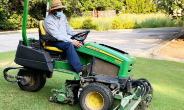 man on riding mower