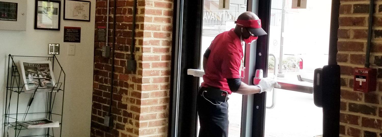 housekeeper cleaning door