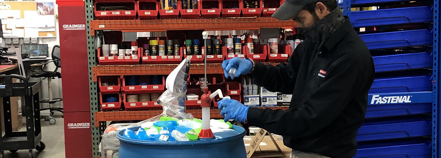 A Warehouse employee prepares materials for workers' welcome kits before campus reopened.