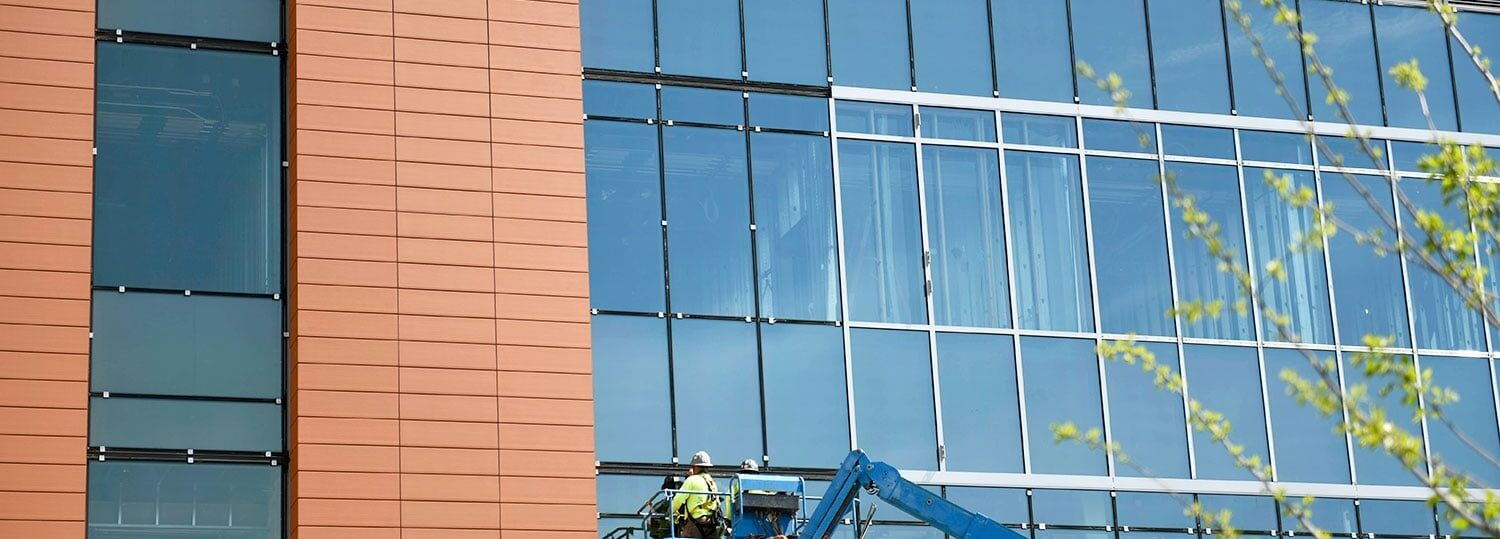 construction worker on lift at NC State's Plant Sciences Building